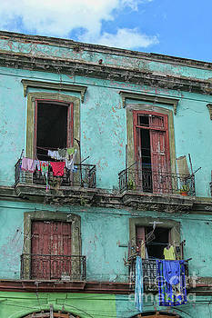 Laundry hanging from old houses in Cuba by Patricia Hofmeester