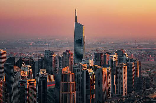 Majestic colorful dubai marina skyline during sunset. Dubai marina, United Arab Emirates. by Marek Kijevsky