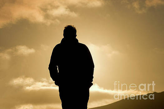 Man walking in sunset by Patricia Hofmeester