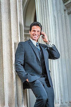 Alexander Image - Middle Age American Businessman talking on cell phone outside of