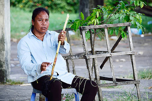 A Cambodian woman doing handwork of bamboo branch in Sihanoukville by Mirko Dabic