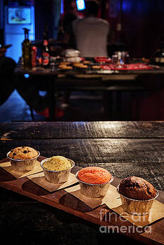 Mixed Freshly Baked Muffins In Cozy Coffeeshop Interior by Jacek Malipan