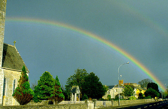 Rainbow in Adare Ireland by Carl Purcell