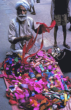 Ribbon Vendor in New Delhi by Carl Purcell