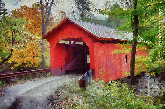 River runs under the Slaughthouse covered bridge by Jeff Folger