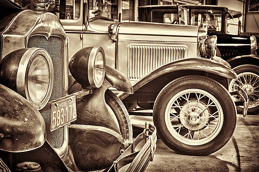 Row of ancient oldtimers in sepia by Martin Bergsma