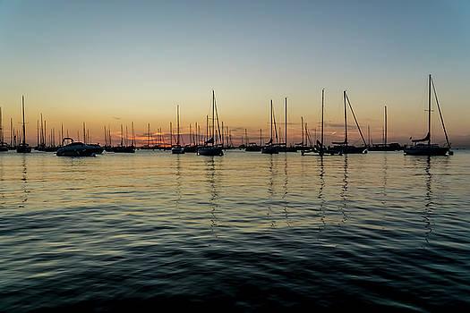 Sailboats at sunrise  by Sven Brogren