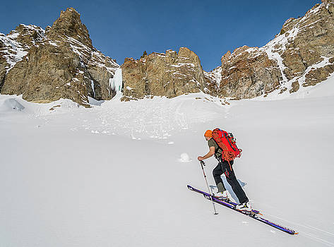 Shane Nelson on approach to Silver Peak ice climbs near Sun Vall by Elijah Weber