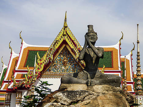 Statue at famous Wat Pho Temple by Helissa Grundemann