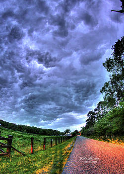 Storm Clouds over Main Street by John Loreaux