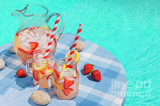 Strawberry lemonade at pool side by Elena Elisseeva