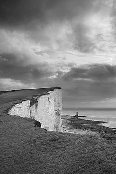 Stunning black and white landscape image of Beachy Headt lightho by Matthew Gibson