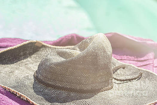 Patricia Hofmeester - Sun hat lying on a towel near the pool