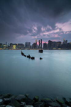 Sunset after the storm,view from destroyed pier in New York by Andriy Stefanyshyn