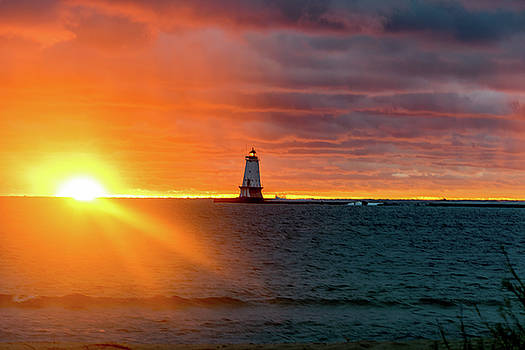 Sunset and Lighthouse by Lester Plank