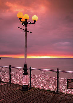 Sunset in Brighton by Marius Comanescu