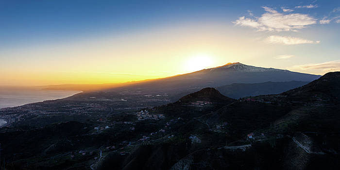 Sunset over the volcano Mount Etna and the gulf of Catania viewe by Alfio Finocchiaro