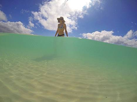 Swimming at Whitehaven Beach on Whitsunday Island by Keiran Lusk