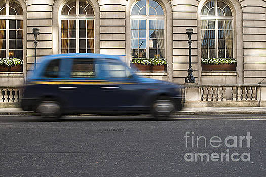 Taxi in motion in London by Deyan Georgiev