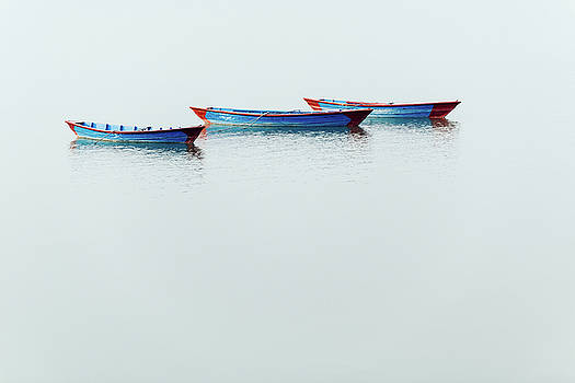 Three blue boats on Phewa Lake in Pokhara by Dutourdumonde Photography