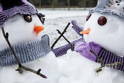 Two cute snowmen friends embracing by Simon Bratt Photography LRPS