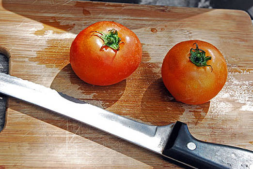 Two Tomatoes On A Cutting Board by Richard Nickson