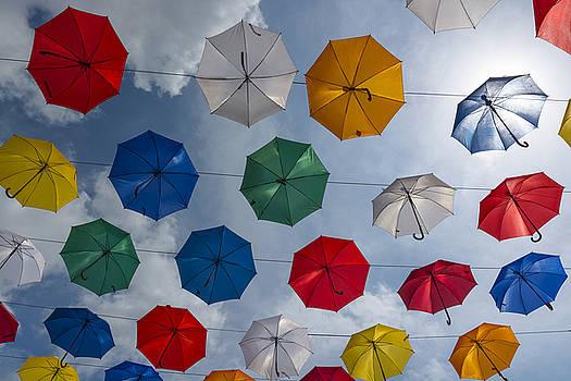 Umbrellas flying by Ayhan Altun