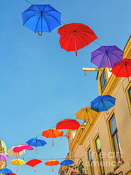 Umbrellas in the sky by Patricia Hofmeester