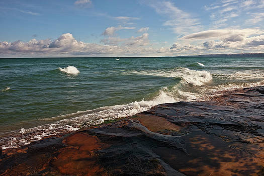 Various autumn clouds form over Lake Superior along Pictured Rocks National Lakeshore. by Larry Geddis