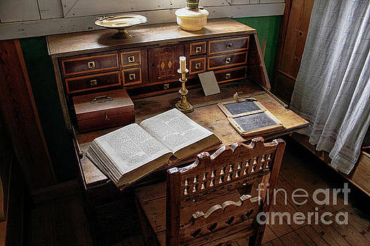 Very old desk with vintage open bible by Patricia Hofmeester