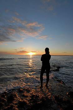 Nano Calvo - Woman enjoying sunset