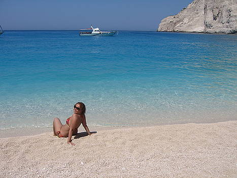 Newnow Photography By Vera Cepic - Woman in water enjoying Navagio beach on the island of Zakinthos
