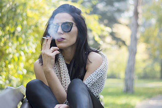 Woman smoking in park by Newnow Photography By Vera Cepic