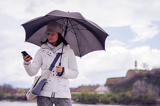 Newnow Photography By Vera Cepic - Woman with hat and umbrella talking on the phone