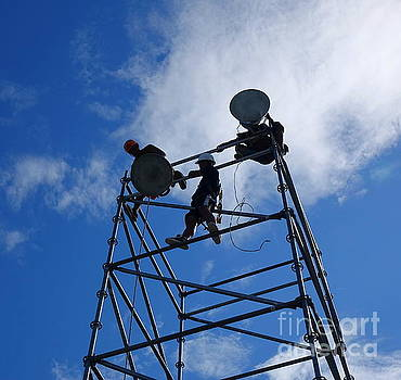 Workers Set Up Powerful Floodlights by Yali Shi