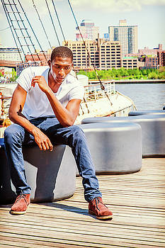 Alexander Image - Young African American Man traveling in New York, thinking outsi