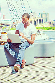 Alexander Image - Young African American Man traveling, working on laptop computer