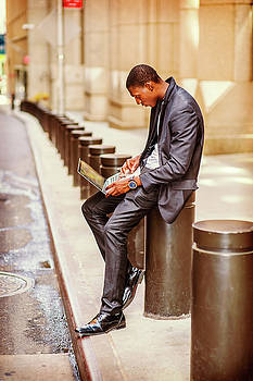 Alexander Image - Young African American Man traveling, working on vintage street