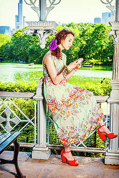 Alexander Image - Young American Woman texting on cell phone, traveling, relaxing