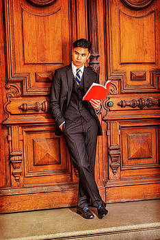 Alexander Image - Young Asian American Business Man reading book in New York