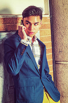 Alexander Image - Young Asian American Man talking on cell phone outside in New Yo
