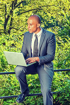 Alexander Image - Young Businessman working on computer outside
