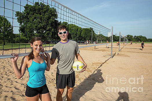 Herronstock Prints - Young fit couple on the at the Zilker Park sand volleyball courts with volleyball on sunny summers day