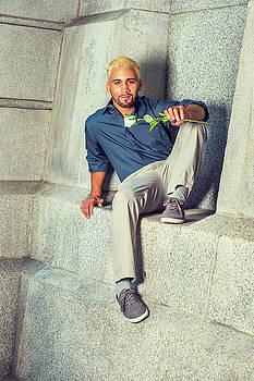 Alexander Image - Young Hispanic American Man missing you, holding white rose, sit