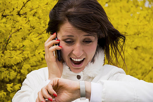 Newnow Photography By Vera Cepic - Young woman talking on the phone and looking at wristwatch