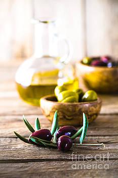 Olives on branch by Mythja Photography