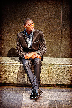 Alexander Image - Young African American Man thinking outside in New York
