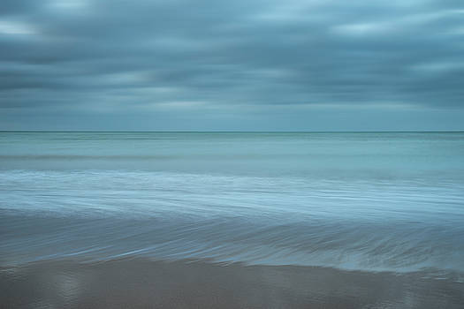 Stunning long exposure landscape image of low tide beach with ro by Matthew Gibson