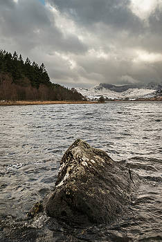 Beautiful Winter landscape image of Llynnau Mymbyr in Snowdonia  by Matthew Gibson