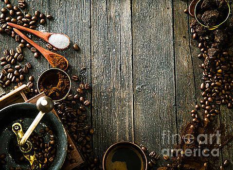 Coffee on wood by Mythja Photography